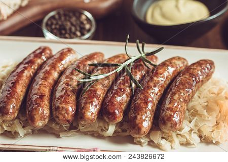 Traditional German Grilled Sausages With Cabbage Salad, Mustard And Beer
