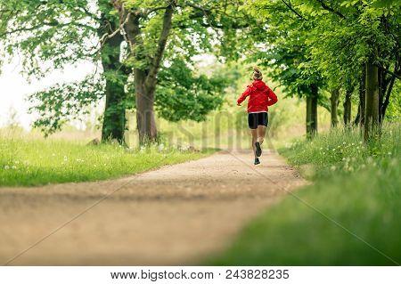 Running Woman, Enjoying Summer Day In Park. Endurance Training, Jogging Or Power Walking Female Athl