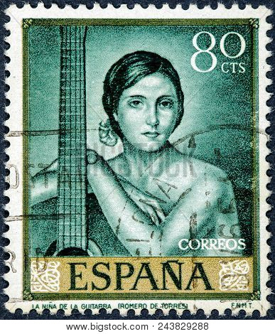 Stamp Printed By Spain Shows The Girl With The Guitar Painted By Romero De Torres