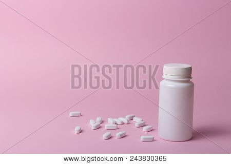 One White Pill Bottle On Pink Background. Storage Pills. Vitamins. Release Pills. And White Pills, P
