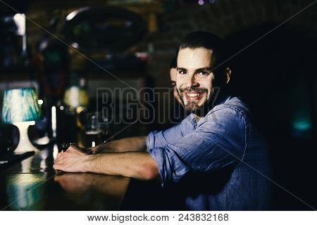 Man Relaxing At The Bar. Guy With Shot Or Liqueur Sitting At Bar Counter. Man With Alcohol Near Bar