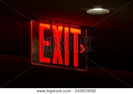 An image of a red lit exit sign