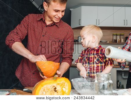Dad And Little Son In The Kitchen, Cook A Pie