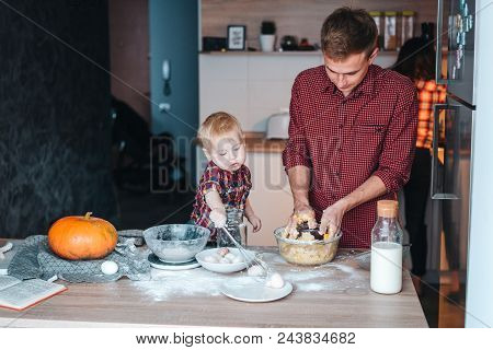 Dad, Mom And Little Son In The Kitchen, Cook A Pie