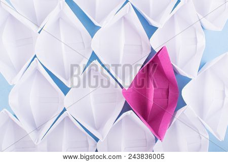 One Unique Pink Paper Boat Among Many Ones. Different Paper Ships As Think Different And Creativity