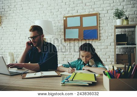 Red Haired Disgruntled Teen Girl Gets Angry With Father, Who Is Busy Doing Things. Fatherhood.