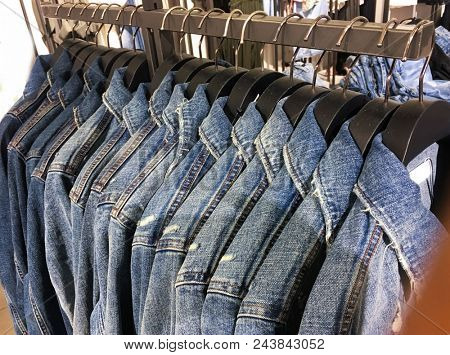 Rows of Blue jacket on hanger in shop