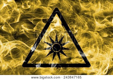 Optical Radiation Hazard Warning Smoke Sign. Triangular Warning Hazard Sign, Smoke Background.