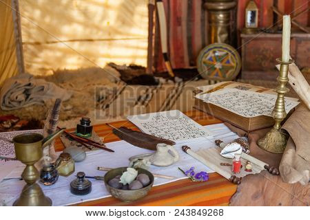 Obidos, Portugal - August 09, 2015: Medieval Moorish scribe tent reenactment in the very popular Medieval Market. Obidos is a medieval town inside walls, and very popular among tourists.