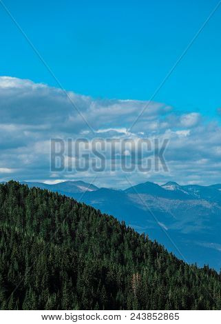 Beautiful View On The High Green Mountains Peaks, On The Blue Sky Background. Alpine Mountain Hiking