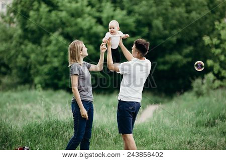 Parents and daughter family portrait. Daddy, mom and child having fun outdoors. Father's day, Mother's day, loving parents, childhood, fatherhood, motherhood, love, happiness poster