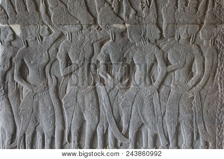 Stone Bas-relief With Human Figures In Angkor Wat Temple, Siem Reap, Cambodia. Male Figures Stone Ca