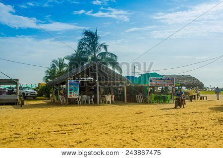 Manabi, Ecuador - May 29, 2018: Unidentified Tourists Eating In A Hut Building In Cojimies Beach, Du