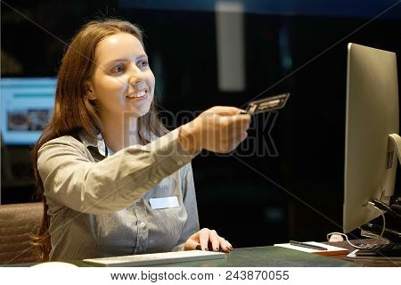 A Smiling Woman-reception Worker Hotel Manager Transmitting The Room Key For New Customers. Profile