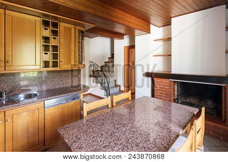 Kitchen with table and wooden furniture. Nobody inside.