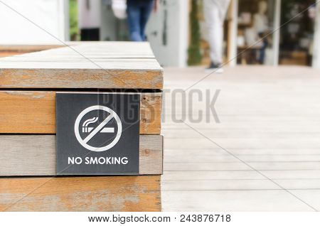 No Smoking Signage On Wooden Background In Public