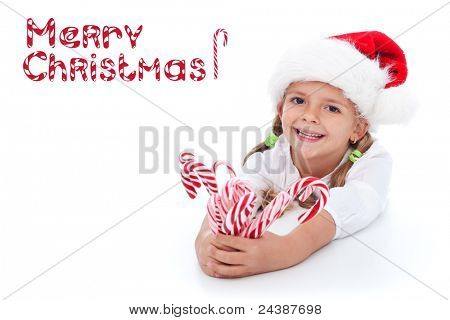 Little girl in santa hat with lots of candy canes - happy holidays