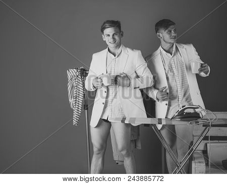 Brothers, Friendship. Fashion Concept. Twin Brothers With Happy Faces. Men With Cups In Dressing Roo
