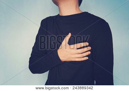 Man Suffering From Chest Pain, Having Heart Attack Or Painful Cramps, Pressing On Chest With Painful