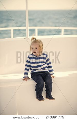 Childhood. Small Adorable Kid Sitting In Boat. Travel And Summer Vacations. Childhood And Baby Care