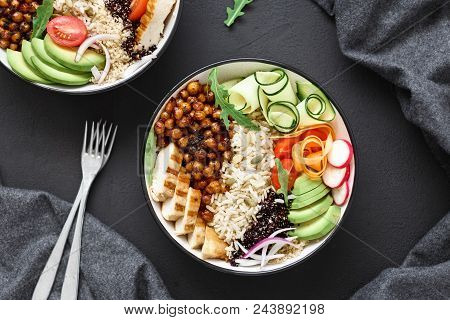 Two Buddha Bowl. Clean And Balanced Healthy Food Concept. Chicken Grilled Steak, Rice, Spicy Chickpe