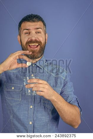 Men Potency. Man With Beard Hold Water Glass On Blue Background, Headache. Painkiller Drug And Antid