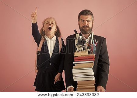 Back To School. Kid And Dad Hold Pile Of Books And School Supplies. Father And Schoolgirl With Confu