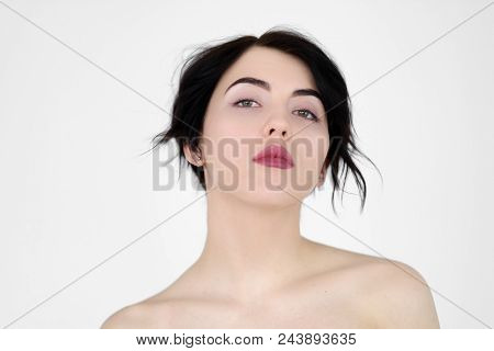 emotion face. defiance provocation dare. wayward confident provocative woman. young beautiful brunette girl portrait on white background. poster