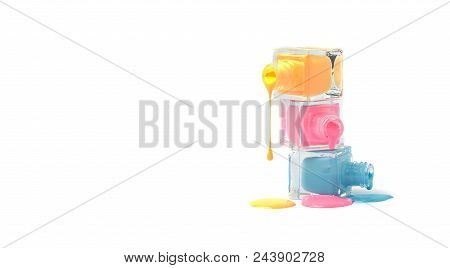 Nail Art Concept. Fine Art Cosmetics And Beauty Image Of A Group Of Three Colorful Nail Polish Bottl