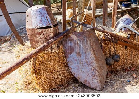 Obidos, Portugal - August 09, 2015: Medieval weapons and armor replicas at the very popular Medieval Market in Obidos. Obidos is a medieval town inside walls, and very popular among tourists. poster