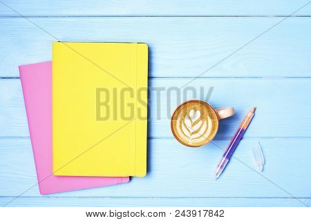 Minimalistic Flat Lay Composition With Girlie Set Of School Supplies On Wooden Table. Woman's Deskto
