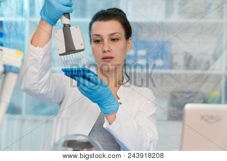 Young woman with genetic research in the laboratory research of cancer diseases