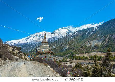 Stone Stupa On The Edge Of A Mountain Road, Nepal.