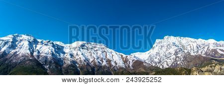 Panorama Of The Snow Mountains In The Himalayas.