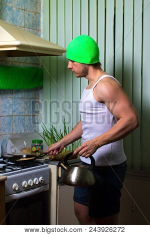 Fitness man cooking