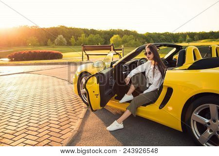 Obsessed With The Cars! Attractive Serious Perfect Gorgeous Young Girl, While Wearing Glasses, Sitti