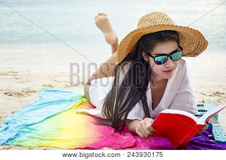 Woman Happy Smiling And Read Books On The Beach On A Beautiful . Pretty Girl Asian In Casual Looking