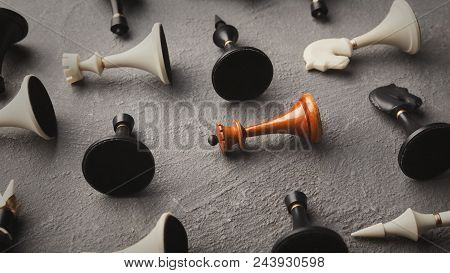 Wooden Queen Lying Among Other Black And White Chess Set On Beige Background. Individuality And Lone