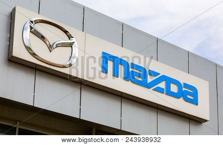 Samara, Russia - May 19, 2018: Mazda Dealership Logo On The Facade Of Official Dealer Office. Mazda