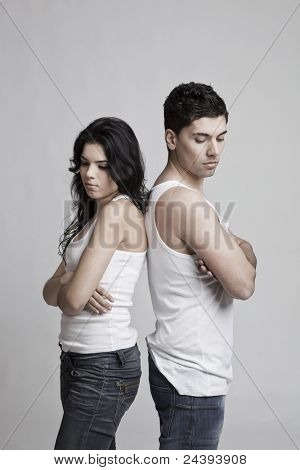 Upset young couple standing over a white background
