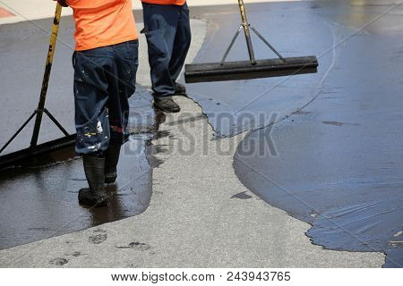 Private drive way, street rehabilitation and slurry seal project finished with crews expertly applying the slurry seal. Re-surfaced Cul-de-sac shown with unidentifiable crew working