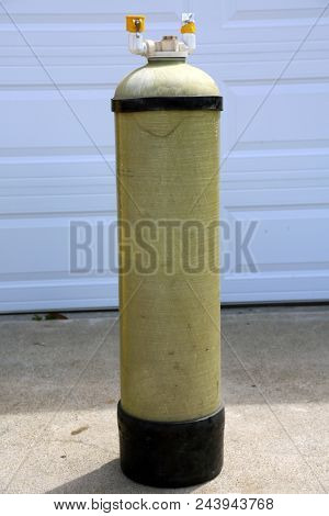 Deionized water filter. Pure Water Filter outside in a driveway. Deionized water is used for industrial and commercial uses including window washing and pharmaceutical mfg.