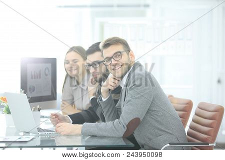 Successful Business Team Sitting At The Desk .photo With Copy Space.