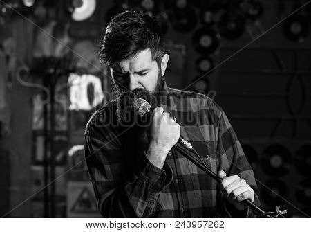 Music And Leisure Concept. Man With Enthusiastic Face Holds Microphone, Singing Song, Karaoke Club B