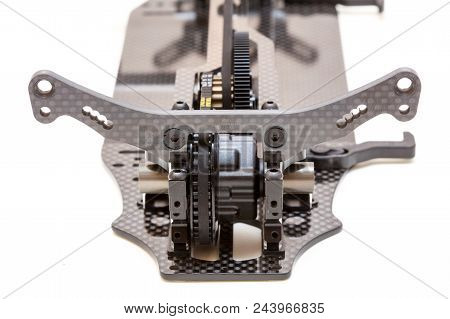 RC car chassis and parts being built to form a radio controlled race car. poster
