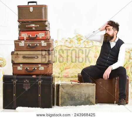 Man With Beard And Mustache Packed Luggage, White Interior Background. Macho Elegant On Tired Face S
