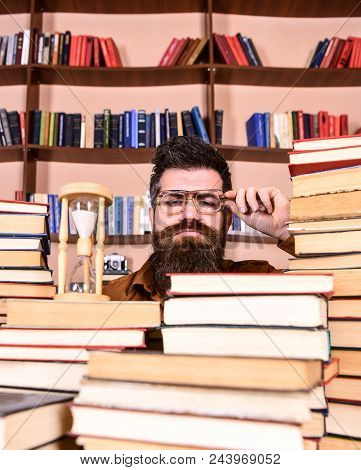 Time Flow Concept. Teacher Or Student With Beard Studying In Library. Man, Scientist In Glasses Look