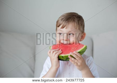 A Small Cute Boy 4 Years Old Is Eating A Watermelon. Summer. Heat. Watermelon. Portrait Of A Happy B
