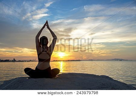 Healthy Good.  Meditation Yoga Lifestyle Woman Silhouette On The Sea Sunset, Relax Vital. Healthy Co