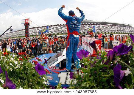 June 02, 2018 - Long Pond, Pennsylvania, USA: Kyle Busch (18) celebrates after winning the Pocono Green 250 at Pocono Raceway in Long Pond, Pennsylvania.
